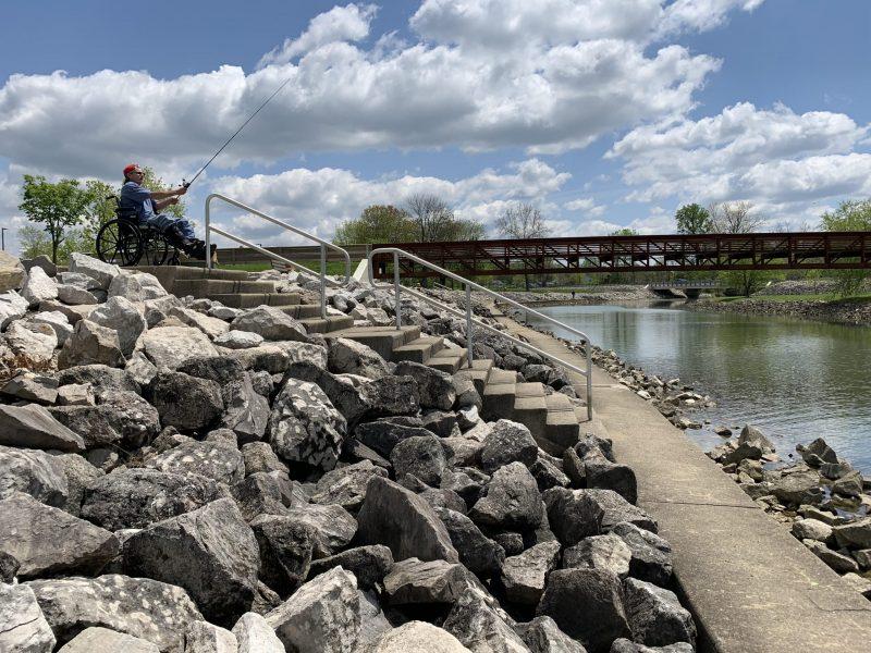 Individual in wheelchair fishing